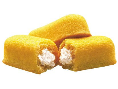 Hostess Twinkie.  Not truly pneumatic, as the internal cavity is filled with adipose tissue rather than air, but do you have any idea how difficult it is to find good images of hollow junk food?