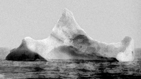 "photo of the iceberg that sunk the Titanic, taken the morning of April 15, 1912 from board of the ship ""Prinz Adalbert"", before knowing the Titanic had sunk. The smear of red paint along the base of the berg (bottom right) prompted the chief steward to take the picture."